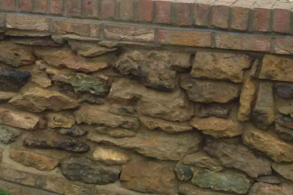 Wall featuring garden-picked stone